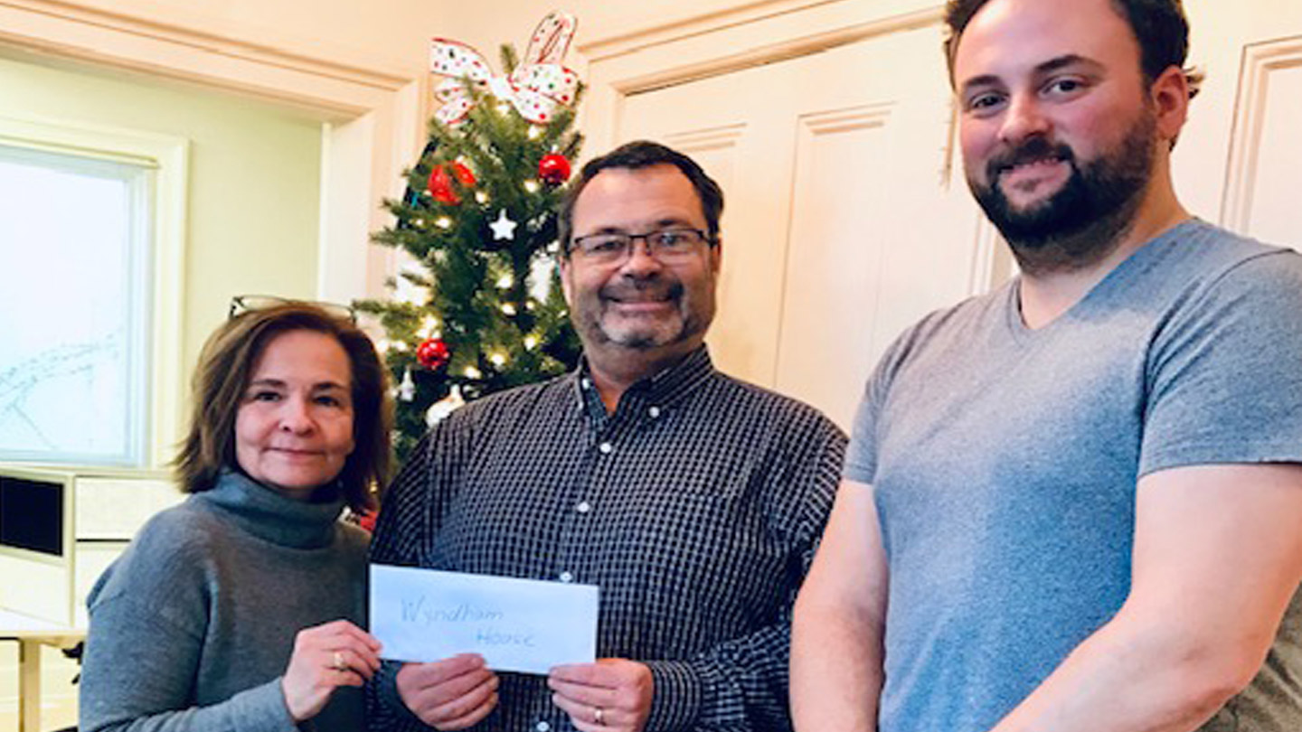 Ed Myers gives cheque to Wyndham House through Employee Community Giving Program
